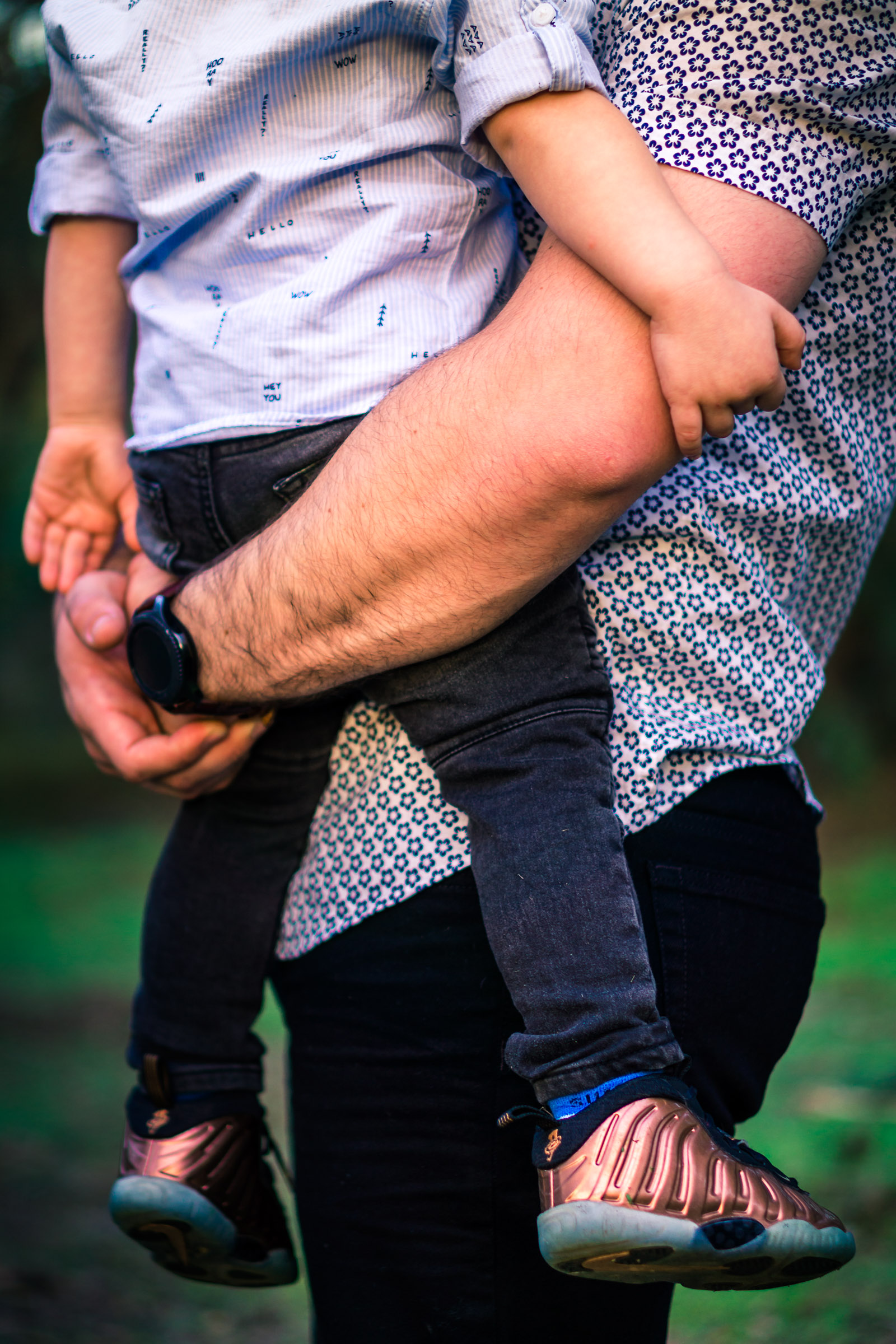 photo of a  father holding his little boy during a family portrait session  on the juanita cooke trail in fullerton orange county taken by joseph barber photography