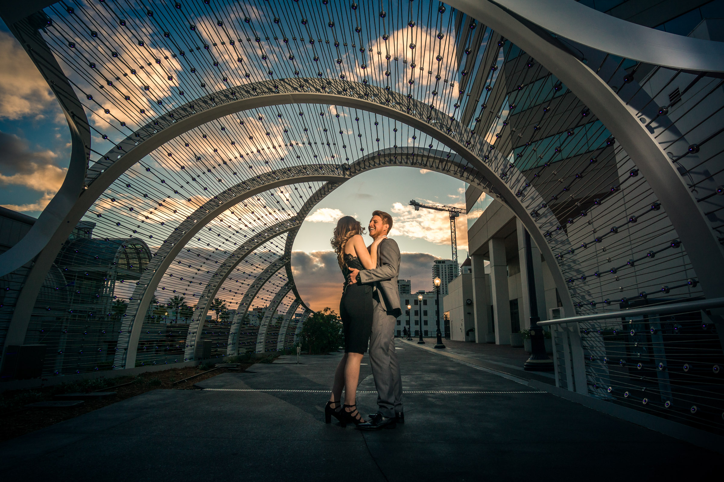 The Long Beach convention centers new rainbow Bridge Framing a couple kissing