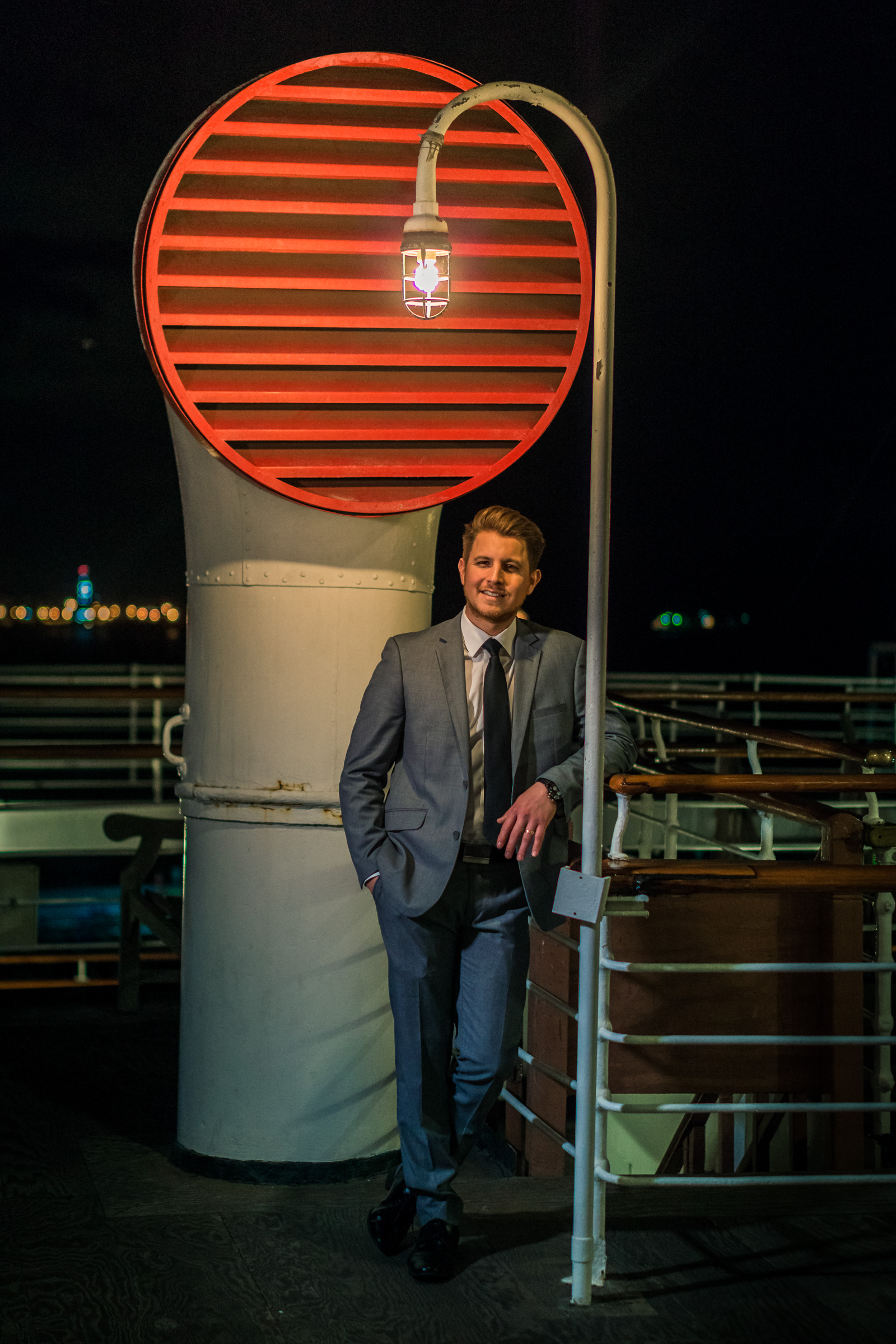 Photo of the groom in a gray suit TakePhoto shoot on the Queen Mary during a couples photoshoto