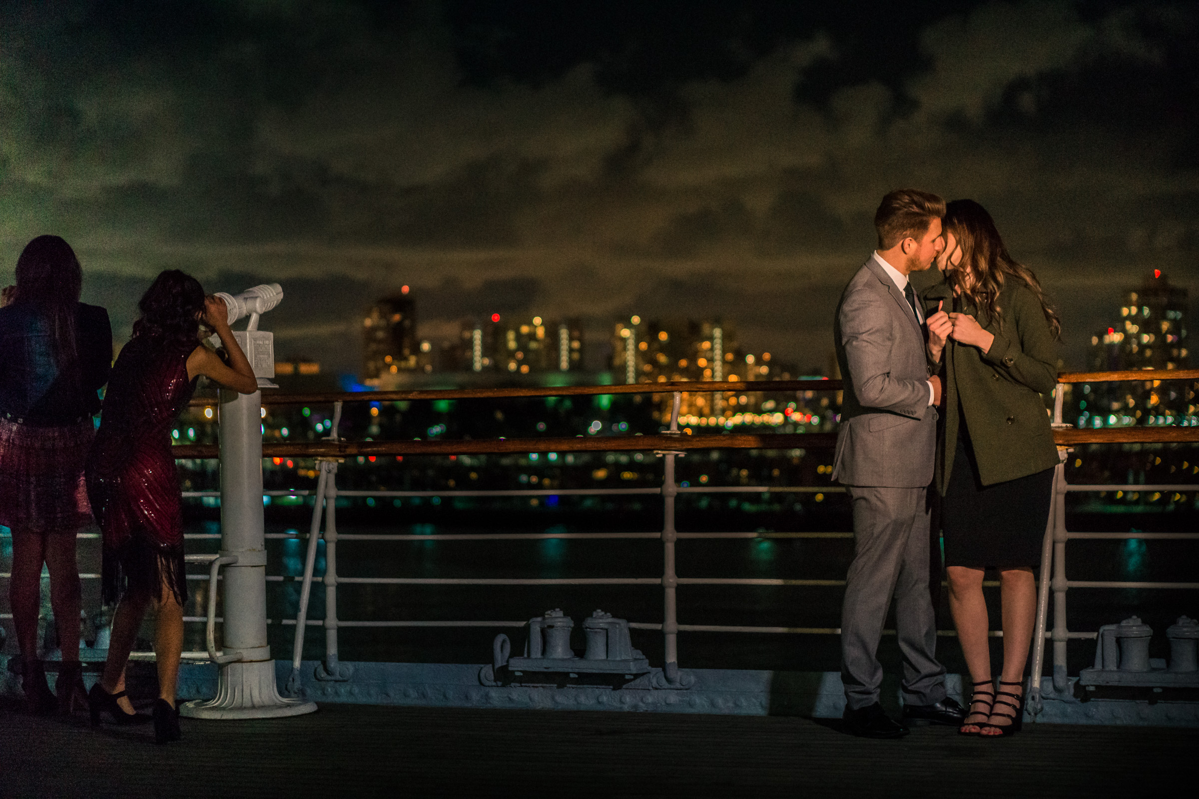 Photo of a couple kissing on the deck of the Queen Mary During an engagement shoot in Long Beach California
