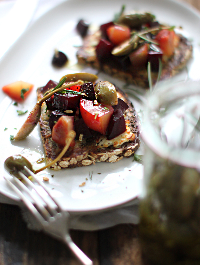 BEET TARTINE WITH MARINATED CAPER BERRIES   By far the classiest dish of the lot, not to mention nutritious, this recipe by  My New Roots  packs a real punch! They're amazingly light and refreshing, too. Just remove the goats cheese for a 100% vegan, plant-based canapé.
