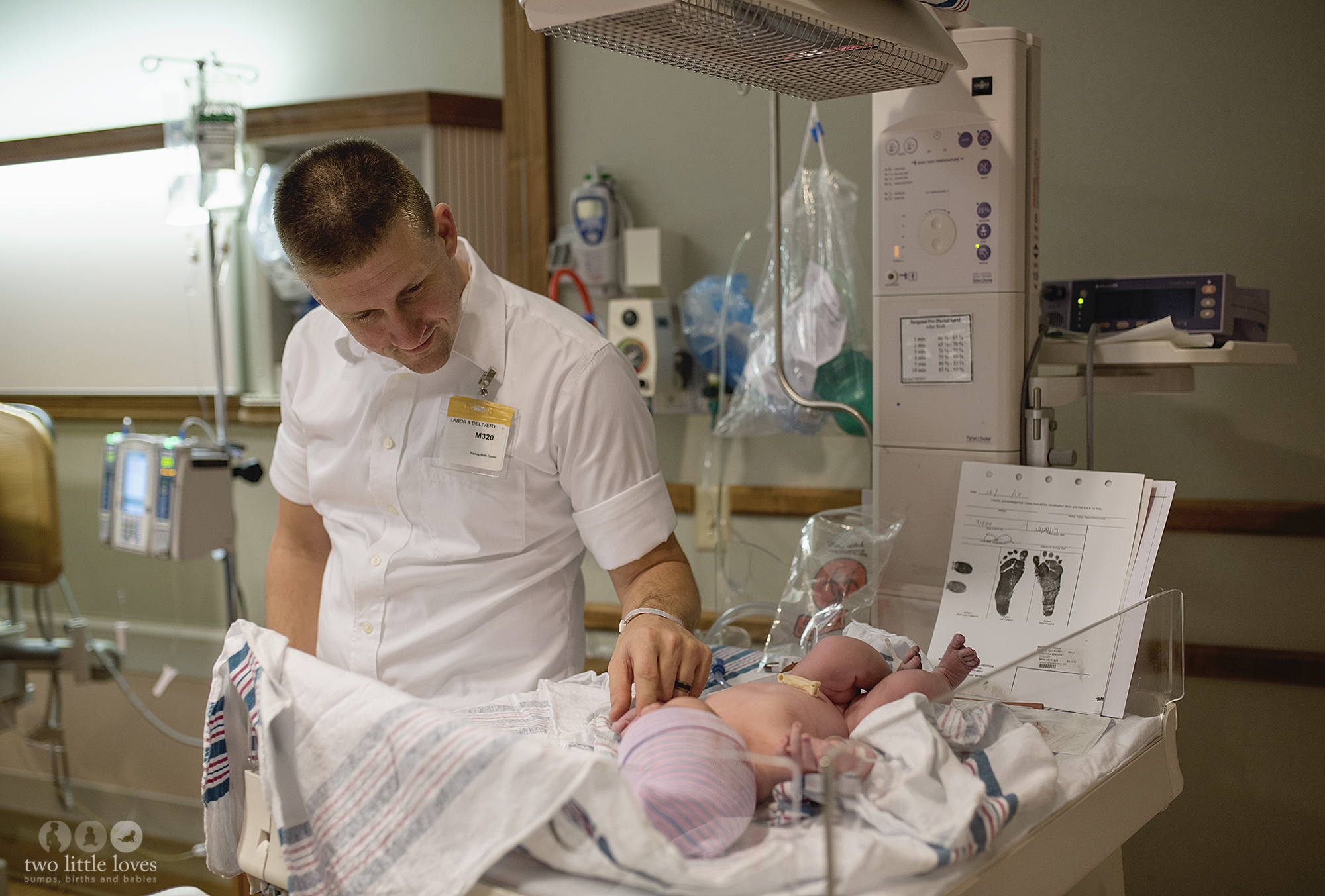 New dad holding his daughters hand after she is born