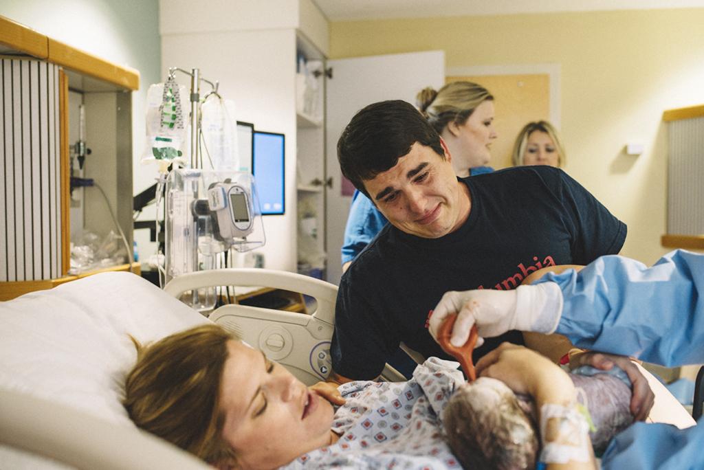 Dad cries over newborn son