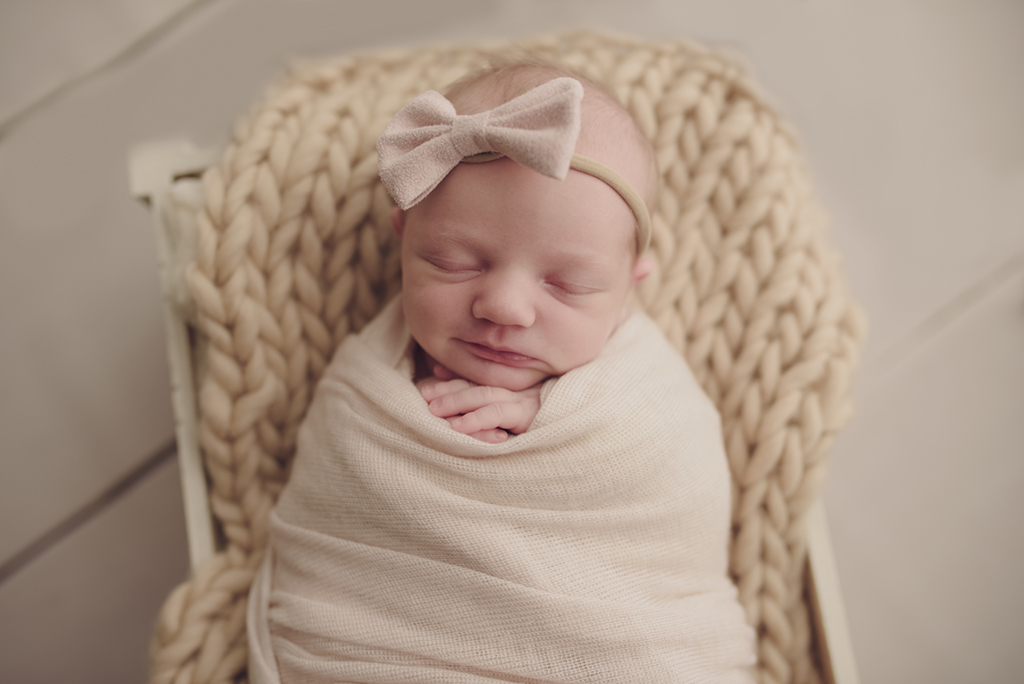 Smiling newborn during photo session in Warner Robins
