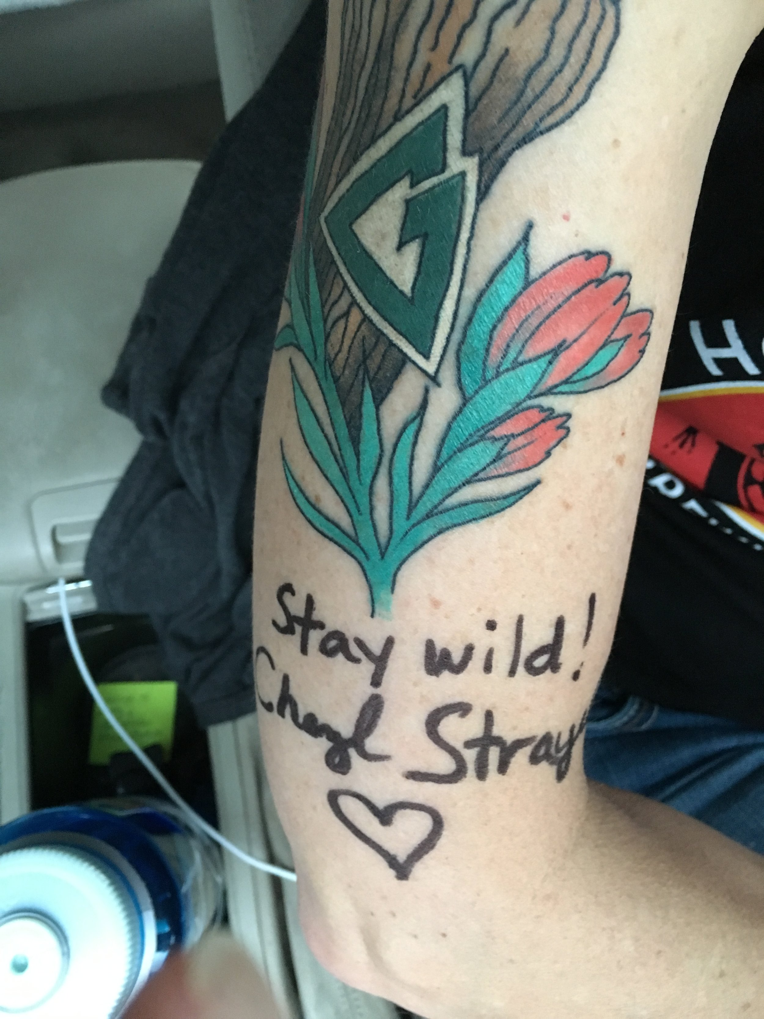 Cheryl Strayed then signed the arm that I may never wash again.