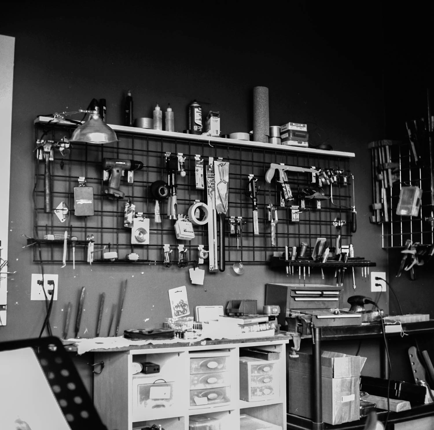 Tools hang in Rob's back office/shop.