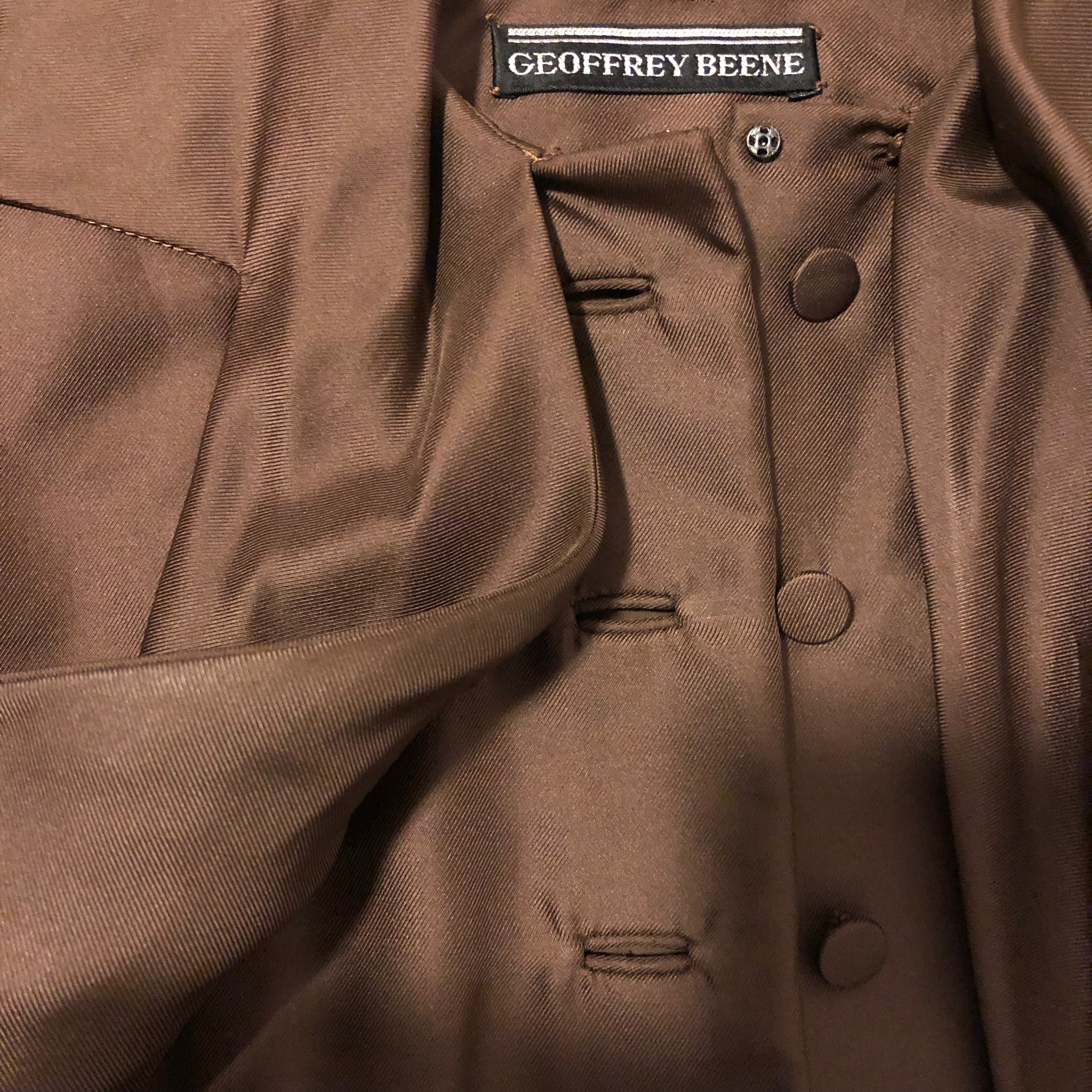 The detailing on this  Geoffrey Beene silk twill dress  is impeccable. You don't find self covered buttons and welt buttonholes in typical garments anymore.