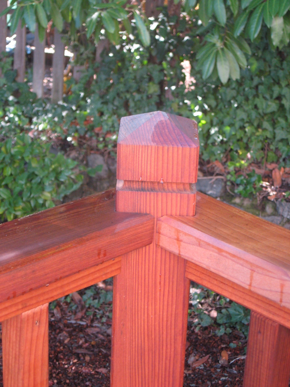 REDWOOD PICKET RAILING CLOSE UP.