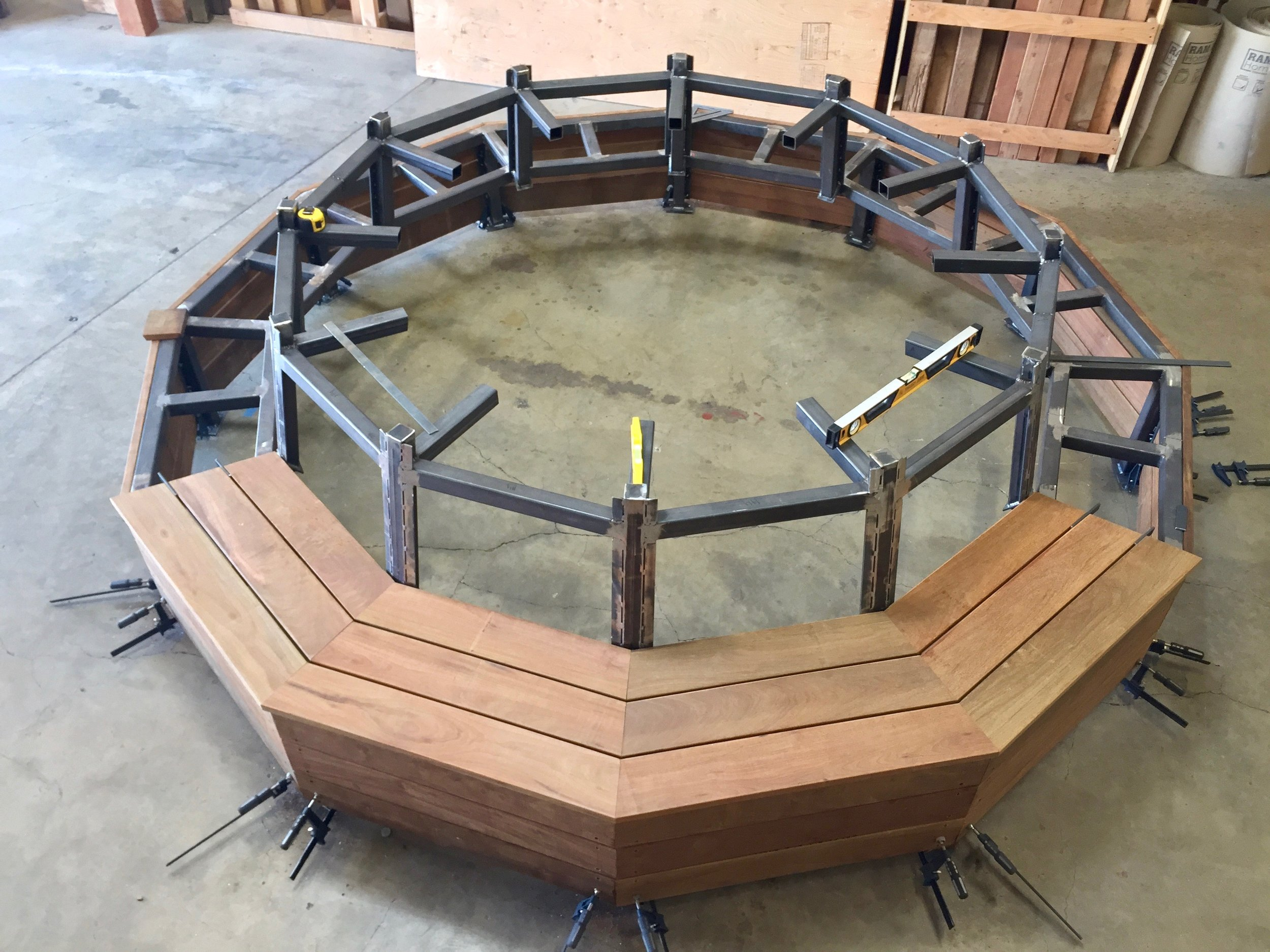 CIRCULAR BENCH SEAT- FLOATING  STEEL SELF SUPPORTED BENCH WITH IPE SURFACING.jpg