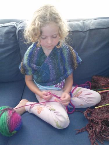 This girl loves to fingerknit