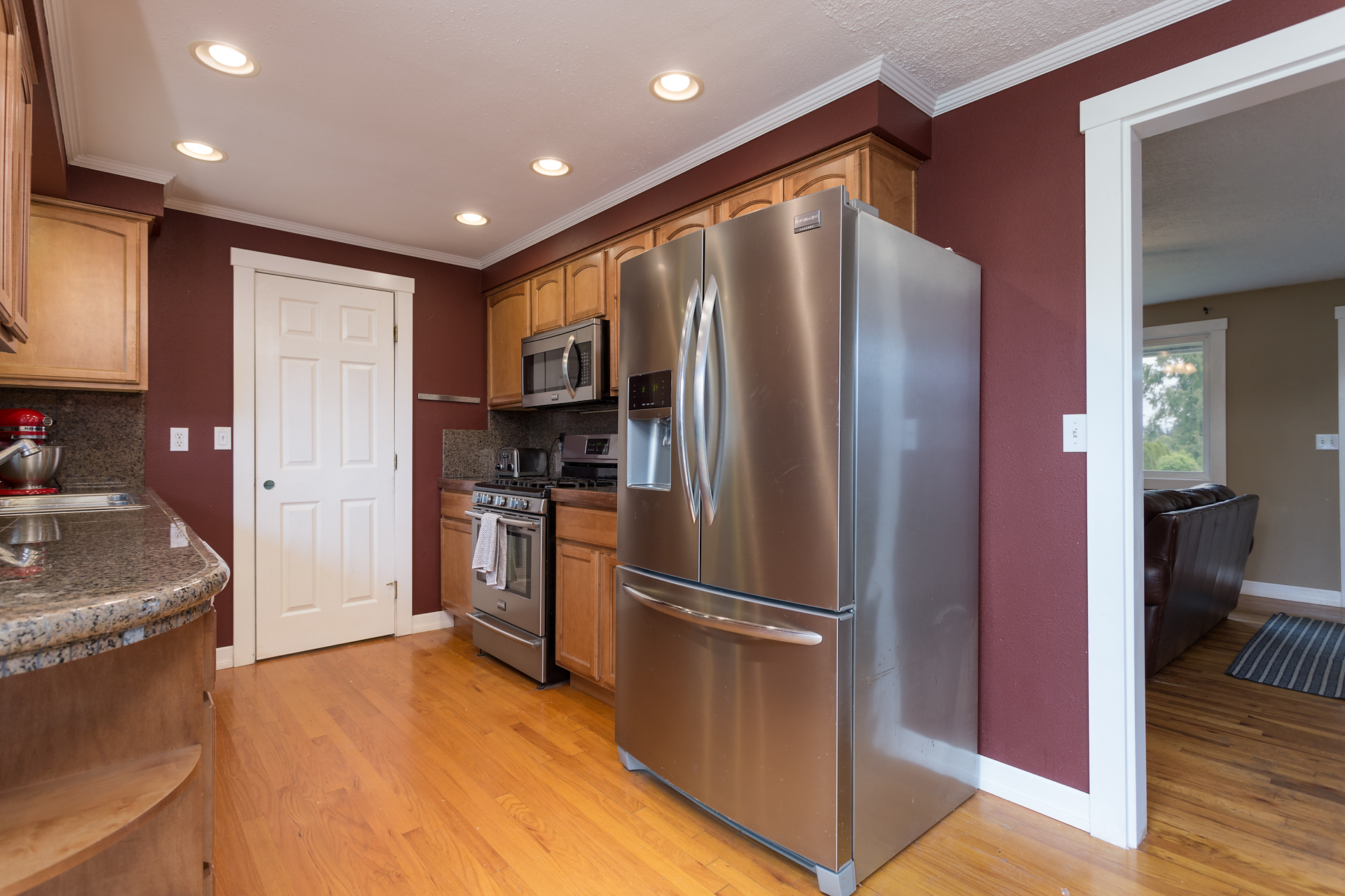 Remodeled kitchen with granite counters and stainless steel appliances.