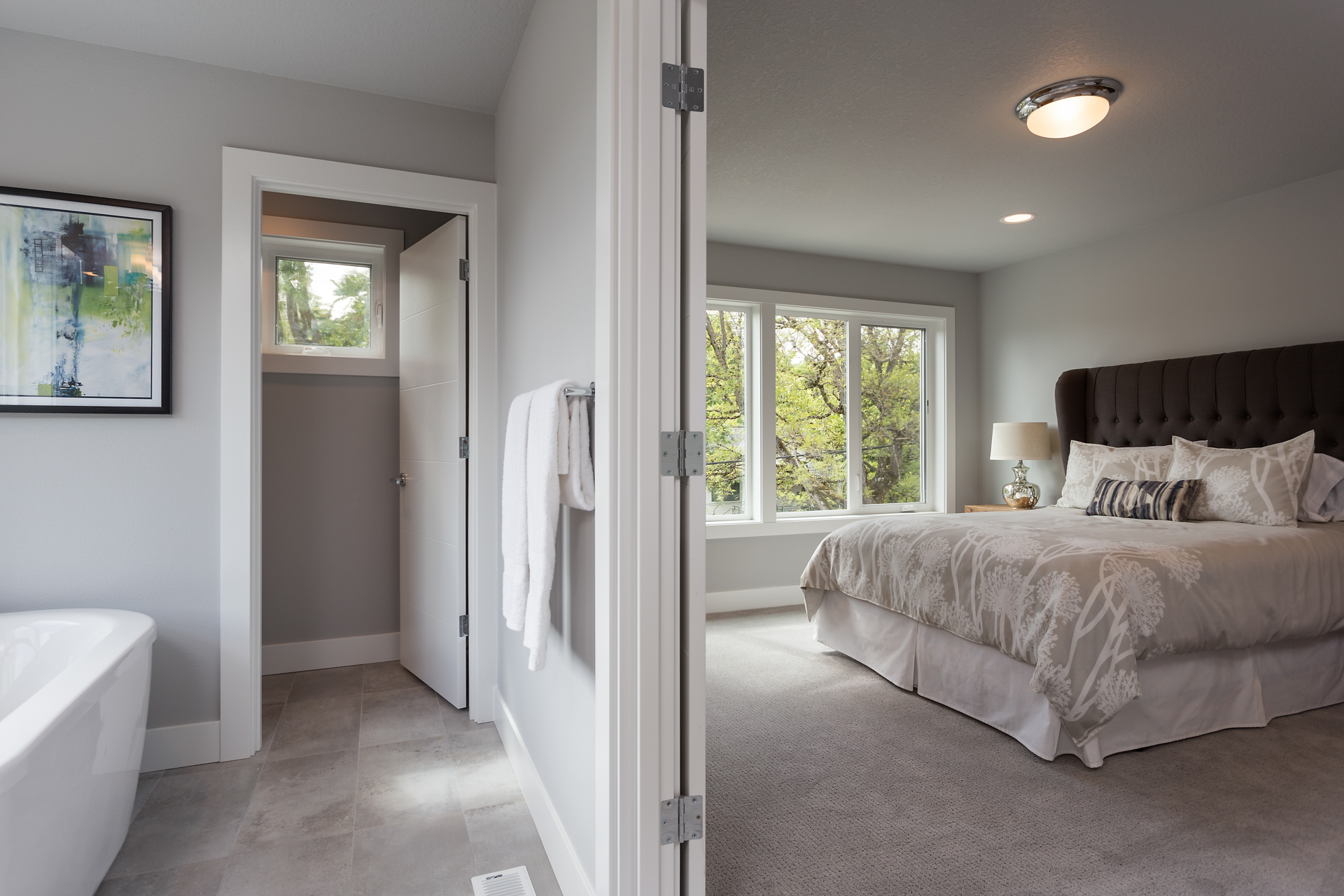 Master suite with large bathroom.