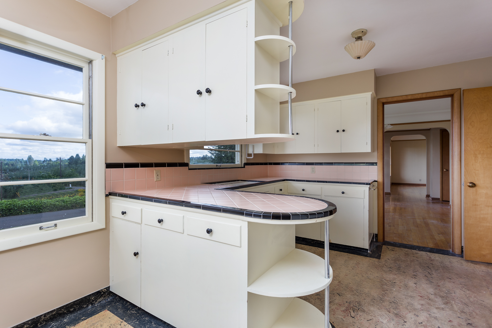 Kitchen with breakfast nook and vintage counters.