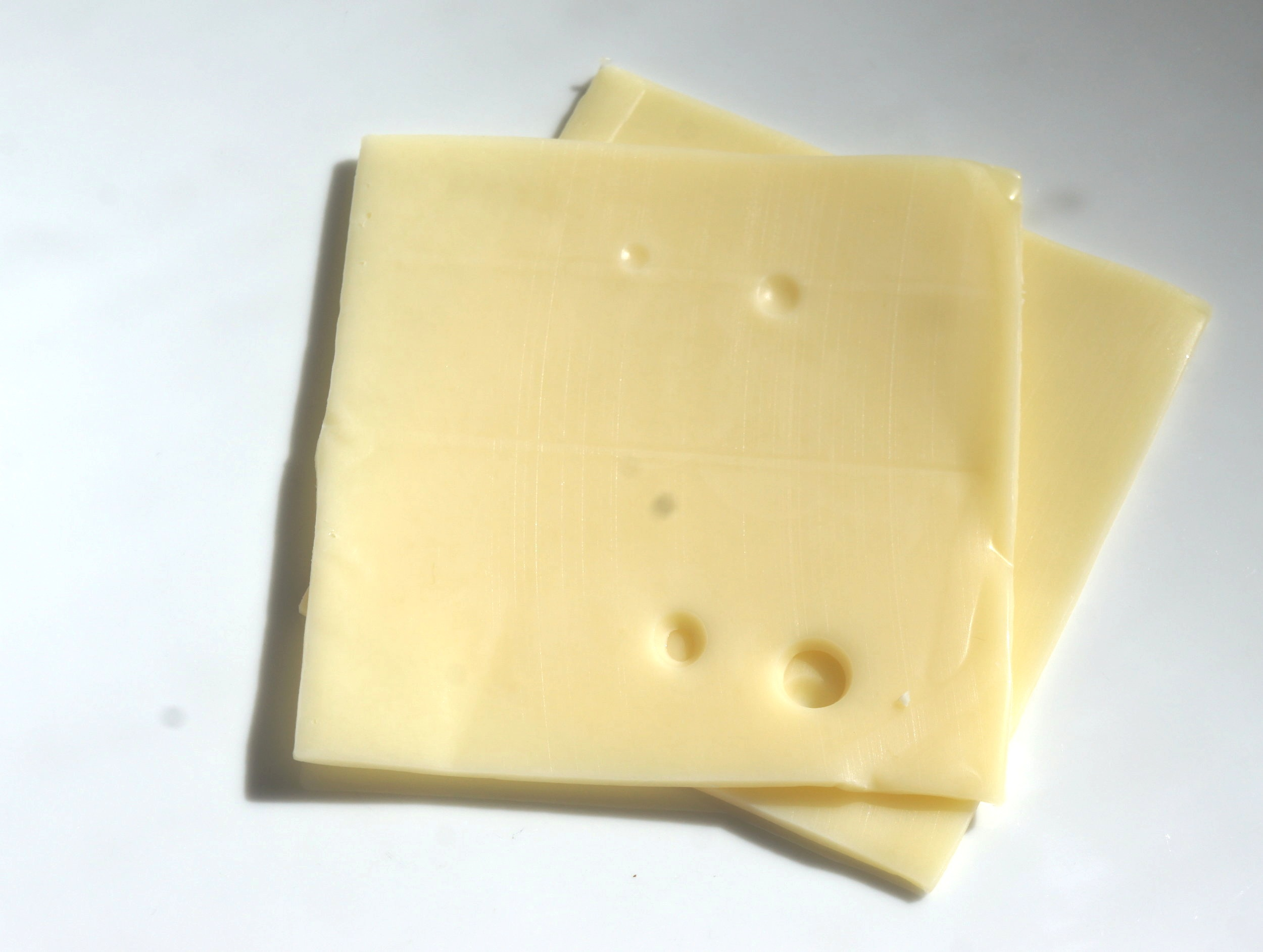 Each slice of cheese will have holes. - Where each slice of cheese is a layer in an architecture, a well designed system ensures that these holes do not and cannot, under any reasonable conditions, line up to let failures in lower layers make it all the way up to failures at the system level.