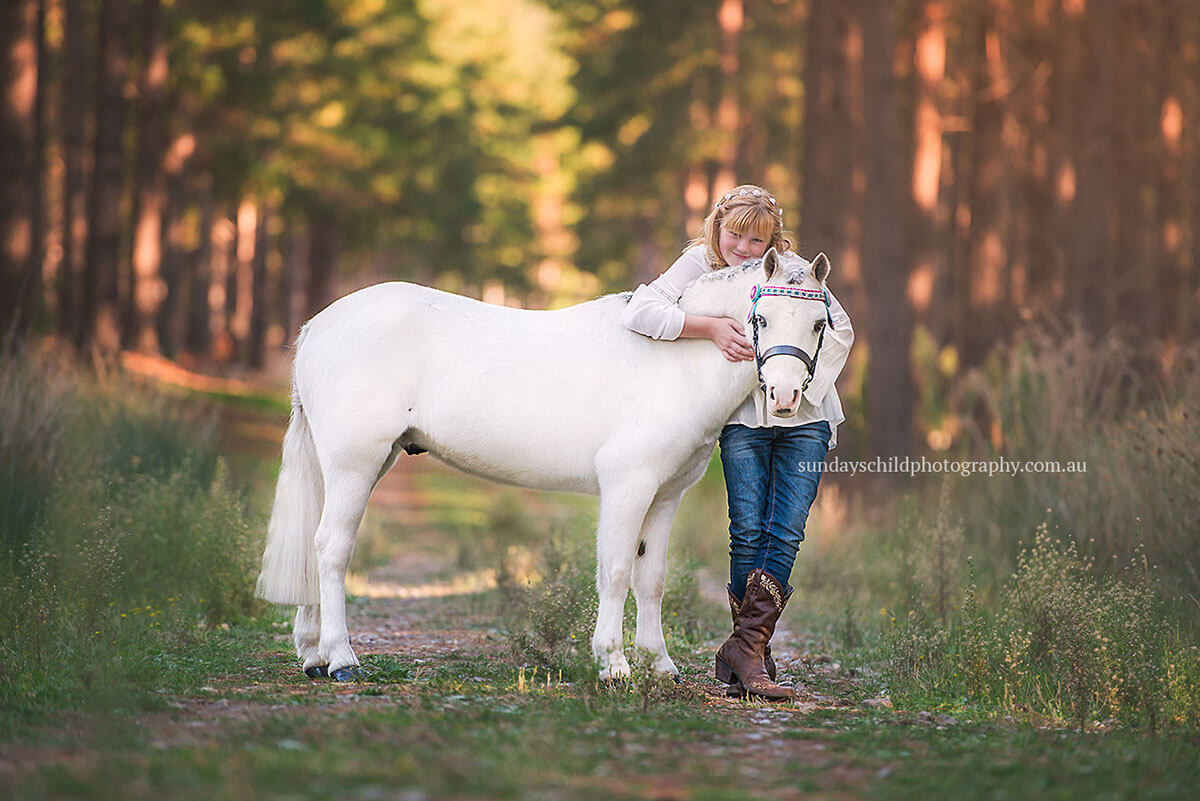 A gorgeous girl and her pony in the forest in the Adelaide Hills