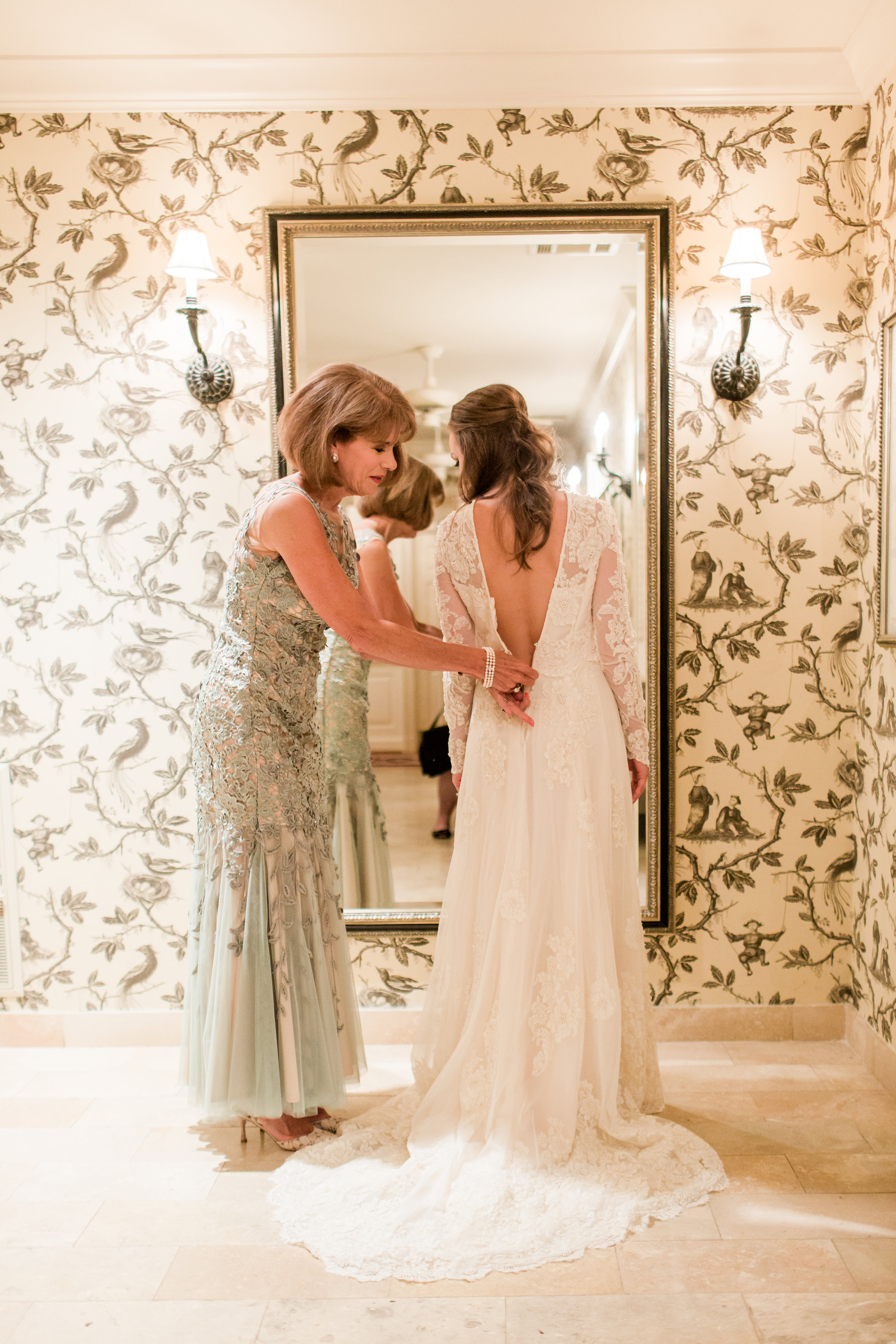 One of the most special parts of the wedding was getting to wear my mom's wedding dress. My mom and dad were married in January of 1976. Her dress came from Neiman Marcus and has stood the test of time.