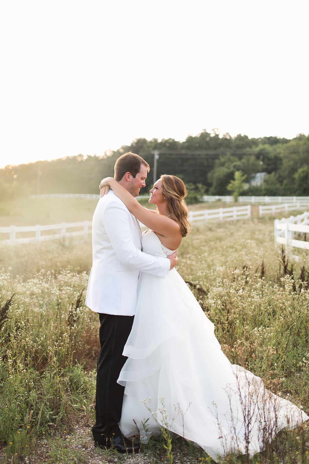 The perfect ending to a wonderful wedding!!   Cheers!  Erin    Location:  Sassafras Springs Vineyard   Photography:  Jo Johnson Photography   Floral:  Zuzu's Petals   Catering:  The Event Group   Paper:  Shindig   Rentals: Eventures  DJ:  Brock Entertainment