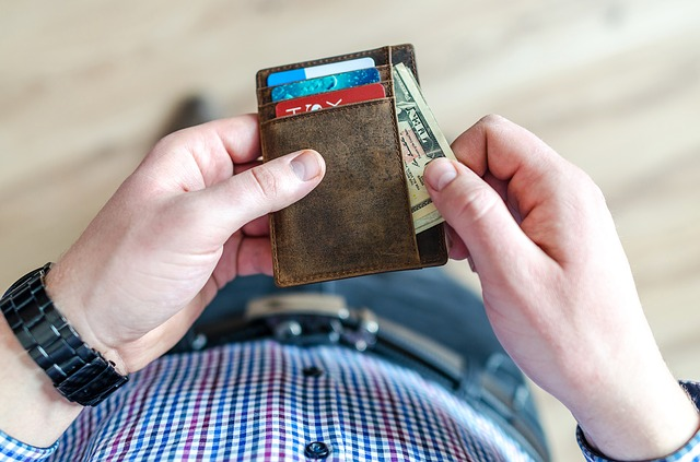 Man pulling money out of his wallet.