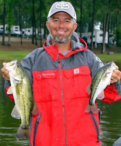 Darold Gleason with Darold Gleason Fishing shows off a largemouth bass (left) and a Kentucky spotted bass (right) that he caught while fishing at Toledo Bend Reservoir on the Louisiana-Texas line near Many, LA. (Photo by John N. Felsher)