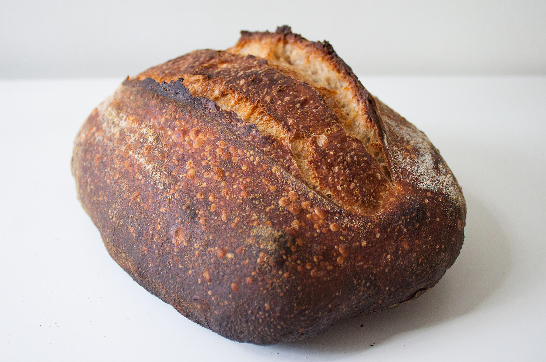 Kingston Country - Our basic country style sourdough. Made with mostly white flour with a small percentage of NY state whole wheat. It has a soft and open crumb and a very mild sour flavor.