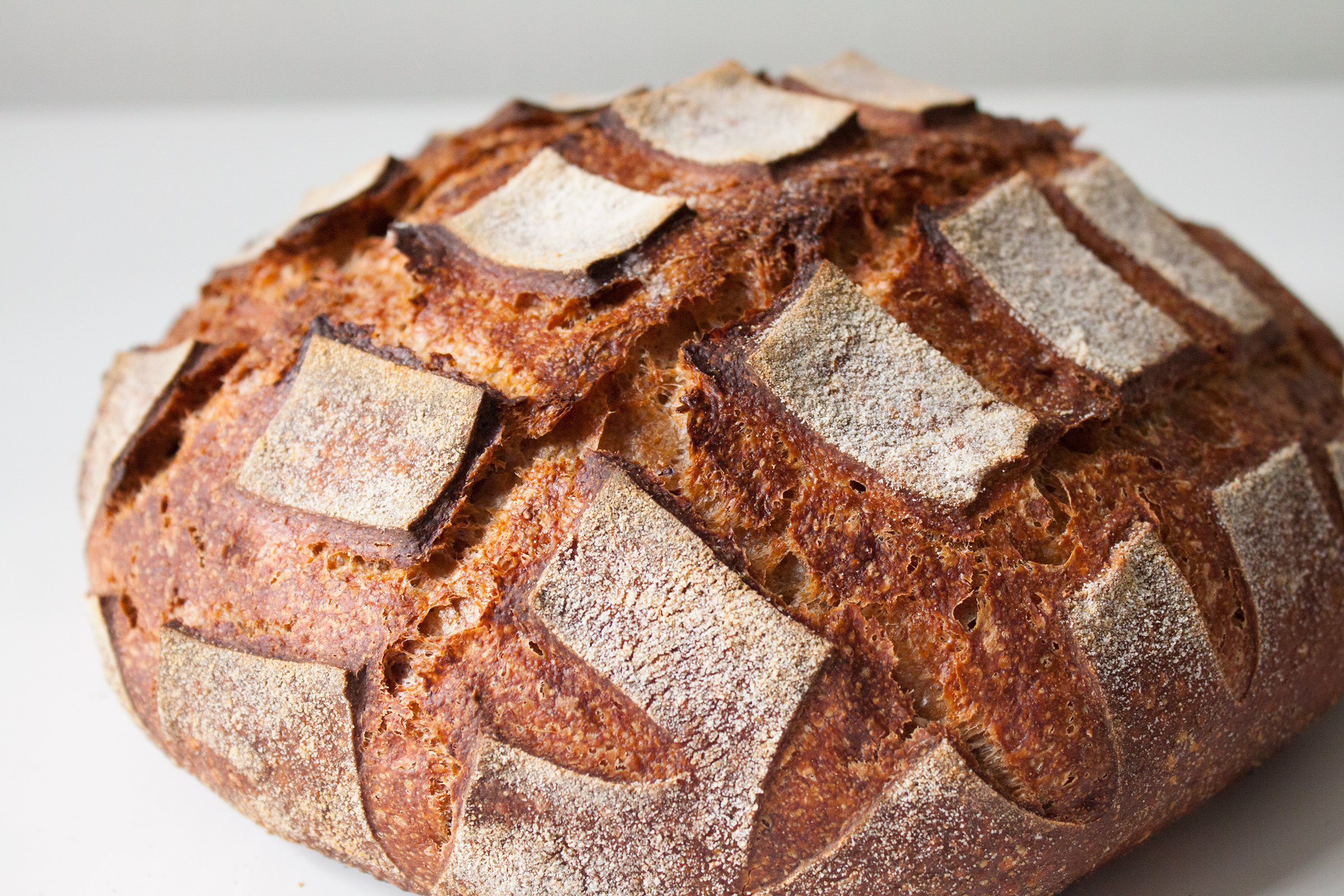 Miche - This is our homage to the noble french style whole wheat bread. It is 100% whole wheat (a mix of red, spelt and rye grain) and is fermented over 48 hours giving it a tender texture and a very strong flavor. A good pairing for a strong wine and a hard cheese.