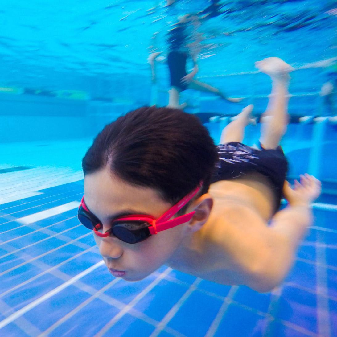 Boy swimming under water.