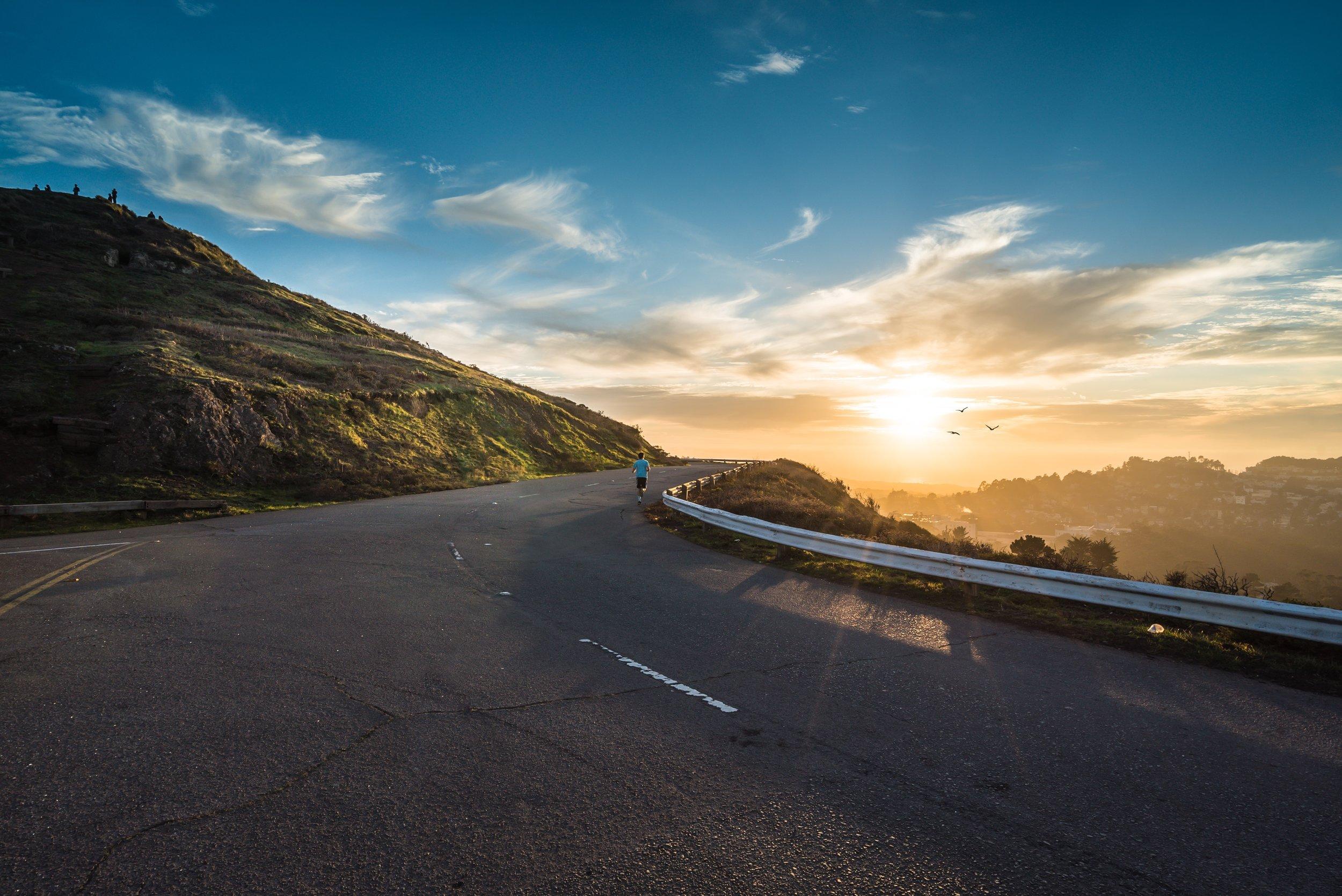 road-dawn-mountains-sky.jpg