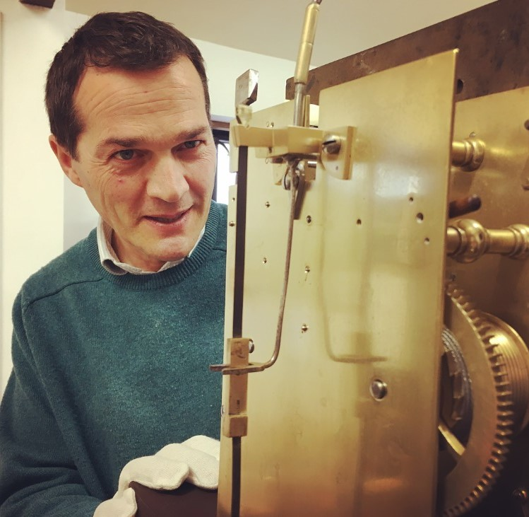 Simon Kerby - Simon started his horological career at G E Marsh Antique Clocks in Winchester, where he remained for nearly 30 years.During his time at G E Marsh Simon completed his apprenticeship, earning himself the rare title of Freeman of the Clockmakers' Company by Servitude.During his time at the bench Simon has been fortunate enough to have been entrusted with repairs to some of the world's most revered clockmakers' works, including Tompion, Knibb, Breguet and Quare to name a few.