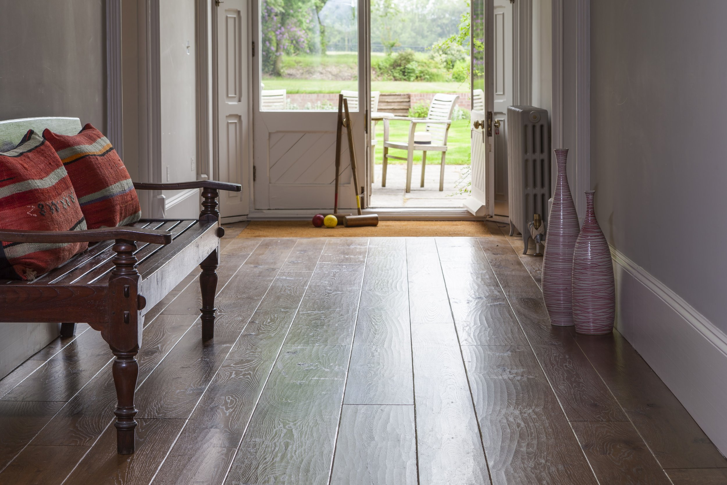 bench in passage Generations wide boards traditional flooring.jpg