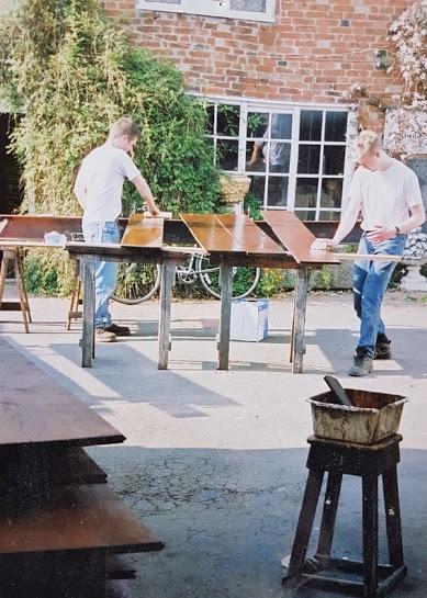 Directors, Dan an Greg oiling baords in the sunshine.