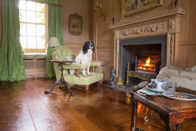 Relaxing by the fireplace, this is a good example of how oak adds comfort to living spaces,in this classical family  home in Wiltshire .