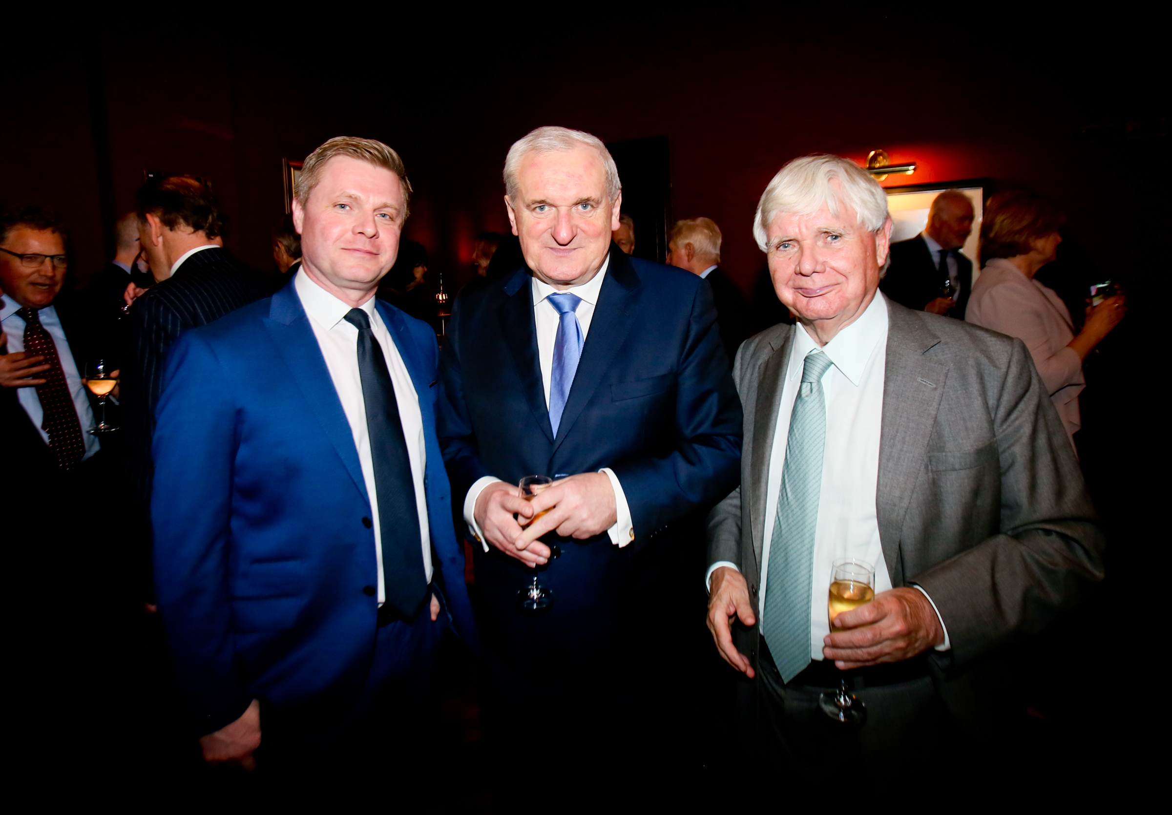 Former Taoiseach Bertie Ahern with Harcourt chairman Pat Doherty and son John Paul Doherty