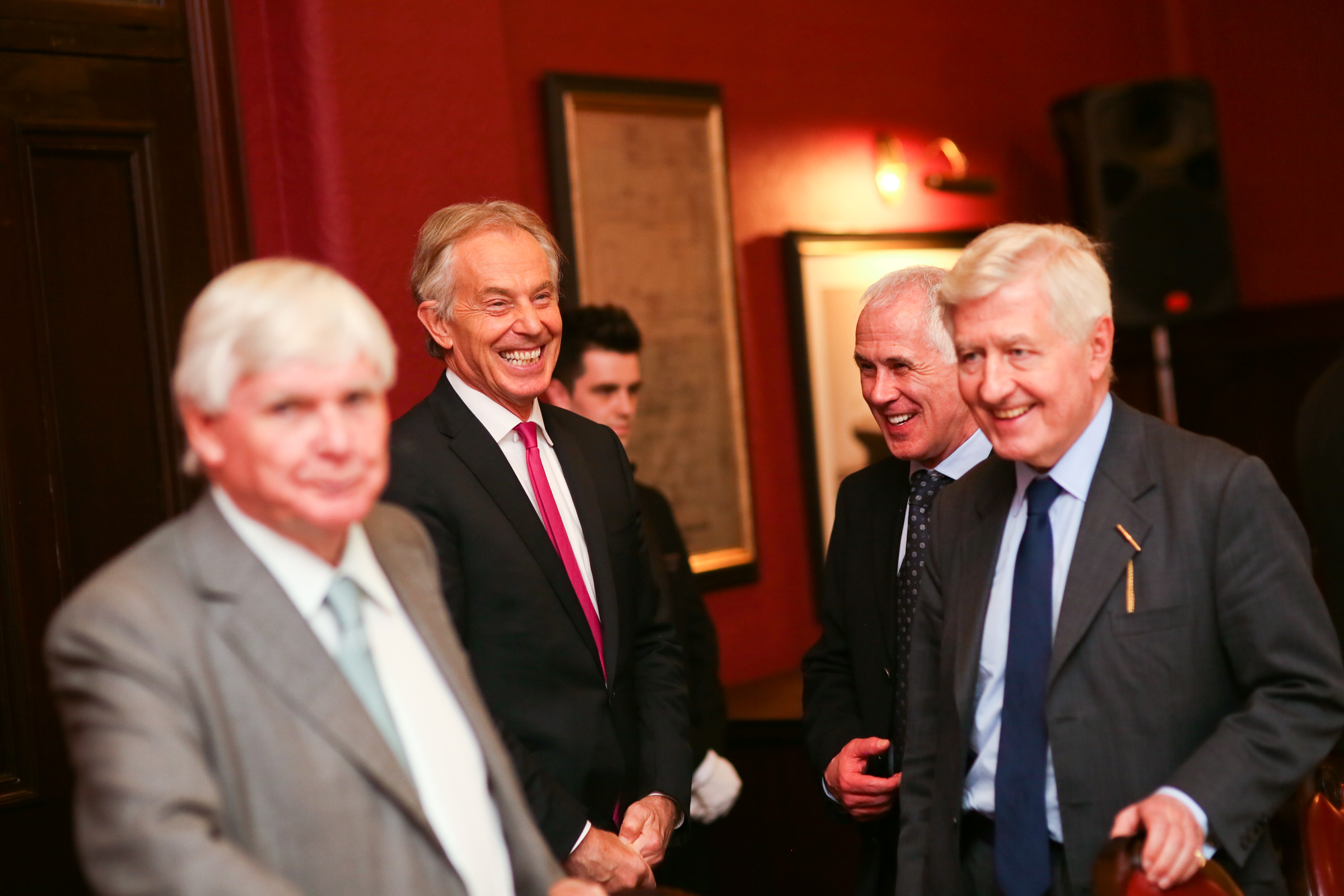 Tony Blair jokes with Co-operation Ireland chairman Christopher Moran