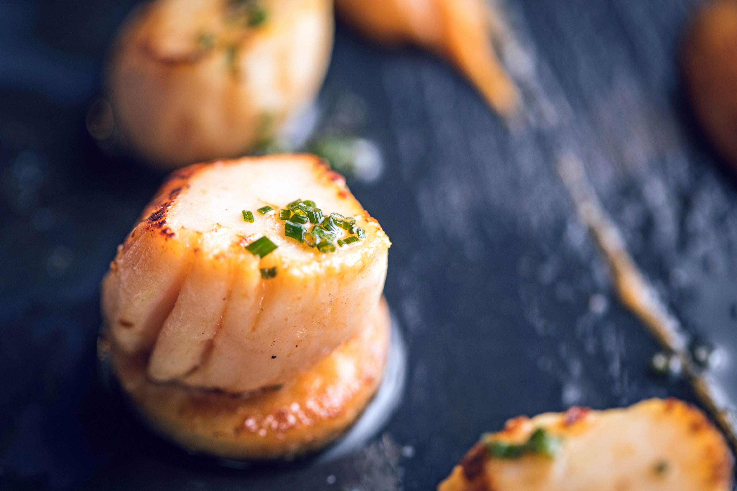 Scallops , perfectly seared in plenty of butter
