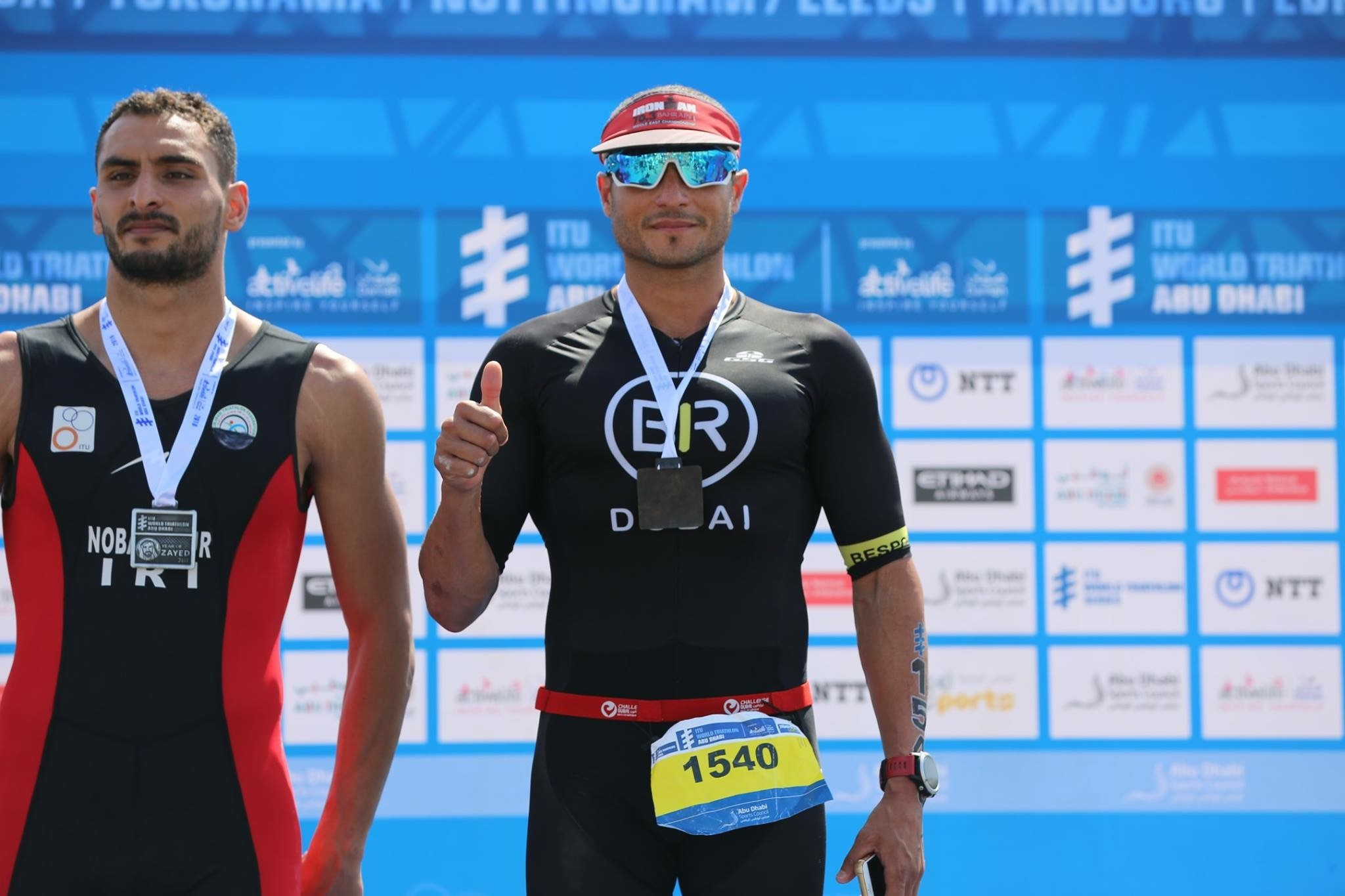 Mohamed Ali Belal (pictured right) after winning the ITU Olympic distance race in Abu Dhabi