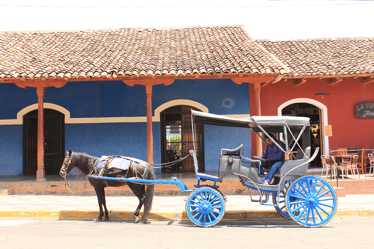 Granada on a horse carriage - break away from the typical city tour and instead blend into this charming Nicaraguan destination