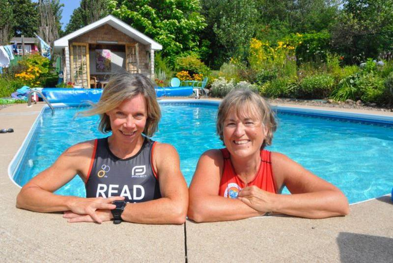 Coach Shannon Read, left, and Masters level athlete Anne Murray cool off in Murray's New Minas pool one sunny day recently.
