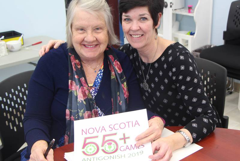 2019 Nova Scotia 55+ Games co-chair, veteran town councillor Diane Roberts, and town director of recreation and special events Tricia Cameron hold a copy of the event's logo which has been recently approved by the provincial board. - Richard MacKenzie