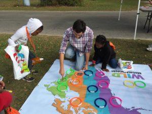 Peter Kleinhenz helps kids play the migration game. Photo by Elizabeth Platt