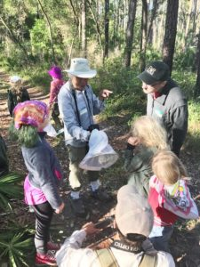 Bioblitz participants check out a butterfly captured by butterfly expert, Dean Jue, at the Aucilla WMA bioblitz. Photo by Andy Wraithmell