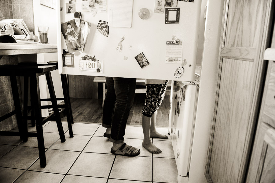 day in the life family photogrphy - two pair of legs and refrigerator door