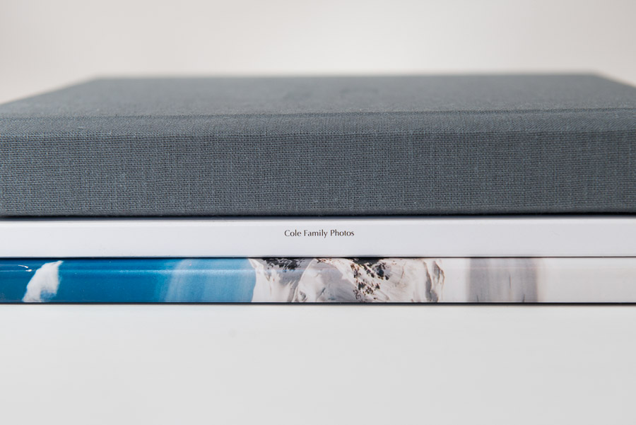 time to print your photos - stack of photo books view from binding