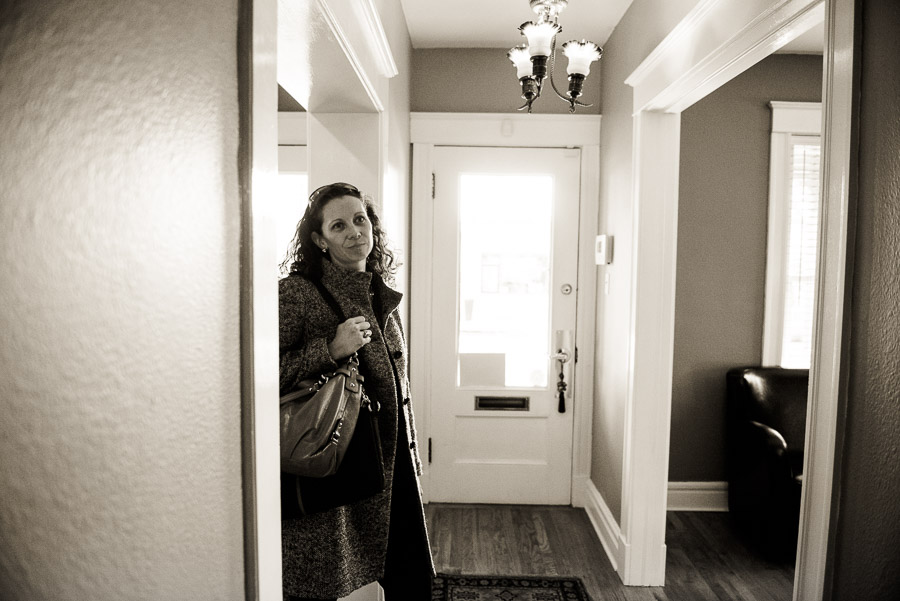 Woman in a hallway talking to unseen person