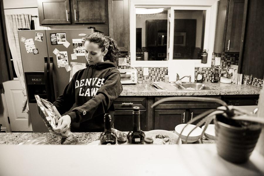 Preparing dinner in her Denver Law sweatshirt.