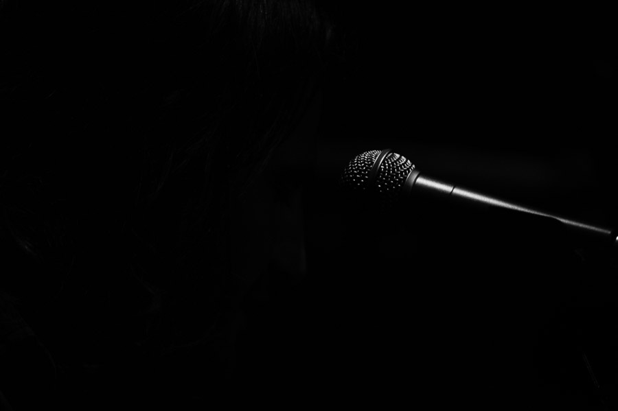 Simple black and white picture of a microphone captured shooting band photography in Denver