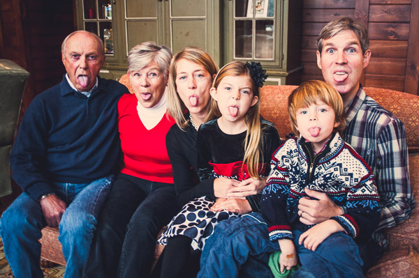Group shot of grandparents, parents, kids all sticking out tongues