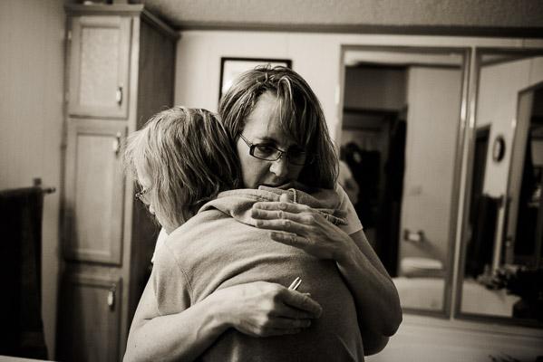 Women hugging.