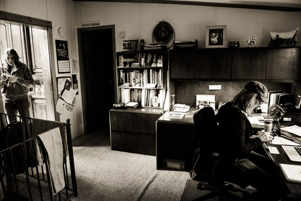 Two women at opposite sides of a home office.