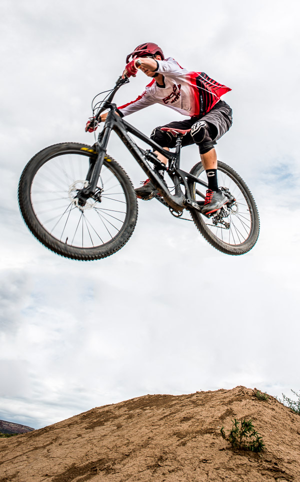 Cyclist up in the air above the ground.