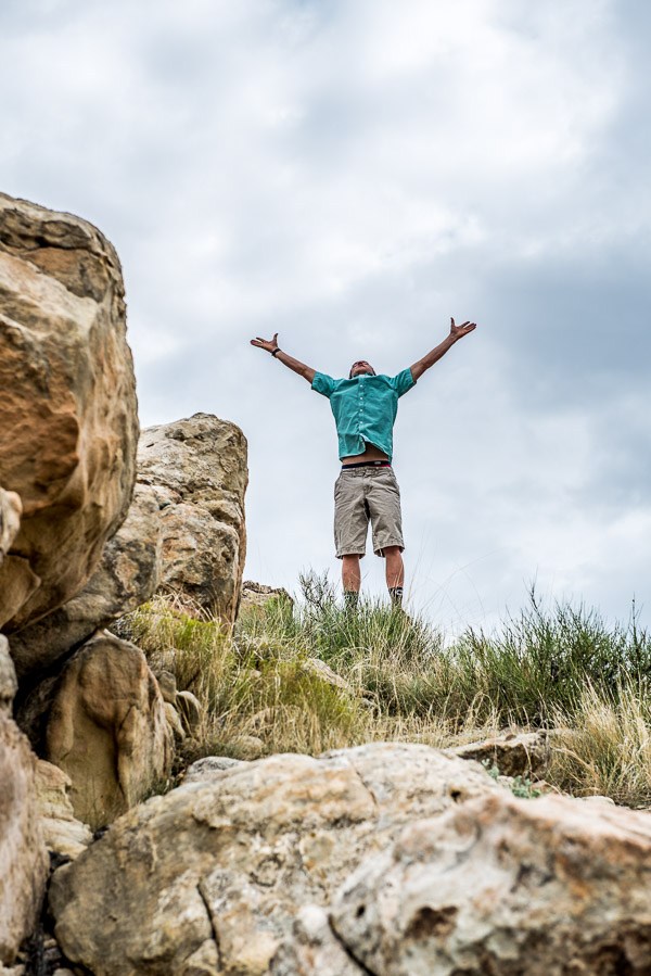 Photo of boy jumping in the air looking at the sky.